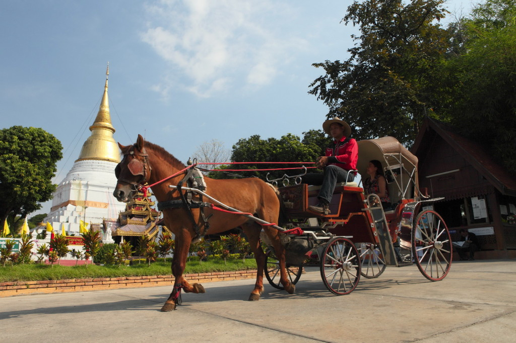 Horse drawn carriages at Phra Kaeo Don Tao Suchadaram Temple, Lampang